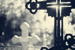 Sepulchral crosses at the cemetery. In beams setting Royalty Free Stock Photo