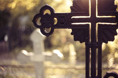 Sepulchral crosses at the cemetery. In beams setting Stock Photos