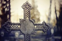 Sepulchral crosses at the cemetery. In the evening Royalty Free Stock Image