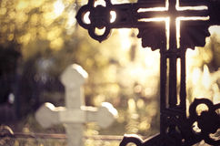 Sepulchral crosses at the cemetery. In beams setting Royalty Free Stock Photography