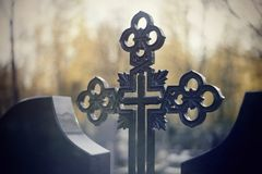 Sepulchral crosses at the cemetery. In the evening Royalty Free Stock Images