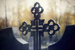 Sepulchral crosses at the cemetery. In the evening Stock Image