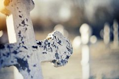 Sepulchral old cross at the cemetery. Sepulchral white old cross at the cemetery Stock Photos