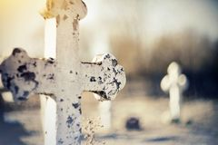 Sepulchral old cross at the cemetery. Sepulchral white old cross at the cemetery Stock Images