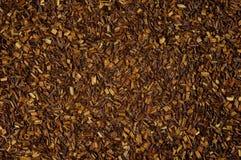 Seque o chá vermelho frouxo de Rooibos, textura, fundo fotografia de stock royalty free
