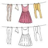 Sequedad de la ropa de la mujer en el viento Imagenes de archivo