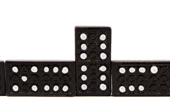 Sequence of black domino parts isolated on white Stock Photo
