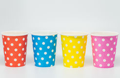 Sequence of Colorful paper cup on white background and selective focus Stock Photography