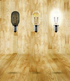 Sequence of ideas thinking at wood parquet room,three bulb in ro Stock Images
