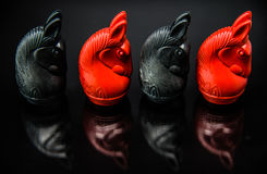 Sequence of Red and Black Knight Thai chess pieces with black background and selective focus Royalty Free Stock Images