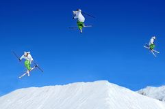 Sequence of skier jumping stock image