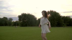 Sequence slow motion of japanese woman in white dress is engaged in ballet. In park stock video footage
