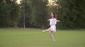 Sequence slow motion of jump japanese ballerina. In white dress in the park stock footage