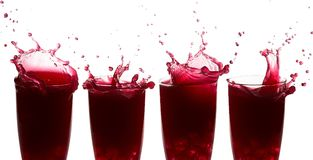 Sequence of splashes on raspberry juice. Against a white background Stock Photography