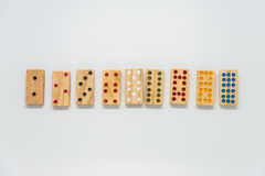 Sequence of wooden dominos on white background with selective focus Stock Images