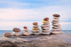 Sequential row. Some different pile of stones in row on the cliff royalty free stock images