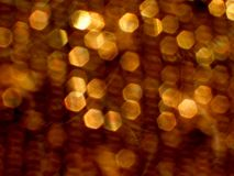 Sequin Burn. Background of highlights off gold sequins royalty free stock images
