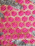 Sequin indian pattern fabric. Pink thread & sequin lace indian vintage pattern Royalty Free Stock Images