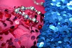 Sequin on pink and blue fabrics Royalty Free Stock Photography