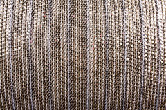 Sequined Background. A background of a white cloth with a pattern of woven sequins Stock Image
