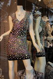 Sequined dancing dress in shop window Stock Photography