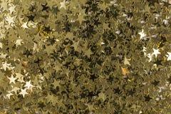 Sequins золотой звезды форменные Стоковое Фото