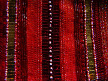 Sequins #2. Red beads and sequins sewn in lines Stock Photos