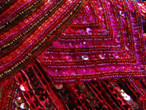 Sequins #3. Pink and Red sequins and beads, sewn in patterns Stock Photography