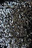 Metallic sparkling sequins scales background, round sequins in fashion dress royalty free stock images