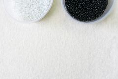 Sequins beads. Container felt. Copy space for text royalty free stock photography