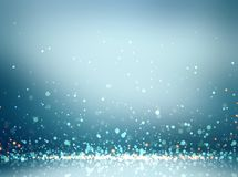Sequins glitter on floor in empty blue room. Empty festive interior. Cold atmosphere room - blurred background. Winter festive. Stylish image for a variety of stock illustration