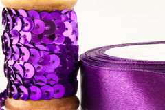 Sequins and ribbon Stock Photos