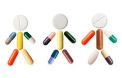 Ser humano con las píldoras Imagenes de archivo