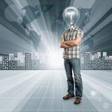 Ser humano principal de la lámpara contra fondo conceptual Fotografía de archivo