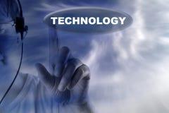 Ser humano y botón con la palabra de la tecnología Imagen de archivo