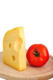 ser naciskający pomidor Zdjęcia Royalty Free