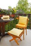 Sera del vino delle feci della sedia del balcone Immagini Stock Libere da Diritti