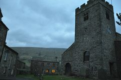 Sera di pietra normanna dell'Inghilterra della chiesa Fotografia Stock Libera da Diritti