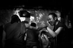 Sera Monastery Debating Monks pointing in fun Lhasa Tibet Royalty Free Stock Photo