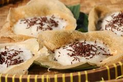 Serabi Solo with Chocolate Sprinkles. Serabi Solo, popular pancake of coconut milk from Solo city in Central Java; sprinkled with chocolate rice. Underlined with Royalty Free Stock Photos