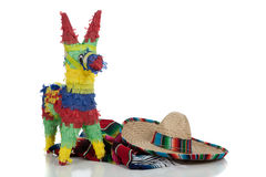 Serape, sombrero and pinata on white Royalty Free Stock Photo