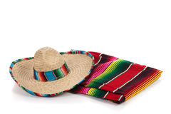 Serape and sombrero on a white background. Mexican Serape and a sombrero on a white background royalty free stock images