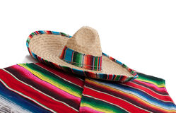 Serape and sombrero on a white background. Mexican Serape and a sombrero on a white background stock photography