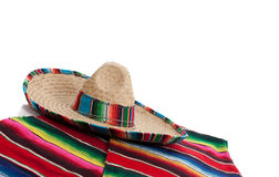 Serape and sombrero on white with copy space. Mexican Serape and a sombrero on a white background with copy space Stock Photos