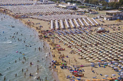 Serapo Beach - Gaeta, Italy. Serapo Beach, aerial view. Gaeta is an important holiday destination in South Italy. The beaches are lined with tourists, the Royalty Free Stock Images