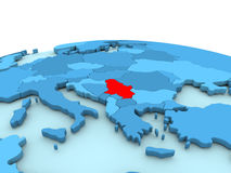 Serbia on blue globe. Serbia in red on simple blue political globe. 3D illustration Royalty Free Stock Photos
