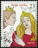 SERBIA - 2015: shows The Sleeping Beauty, series Characters from children`s books. SERBIA - CIRCA 2015: A stamp printed in Republic of Serbia shows The Sleeping stock photography