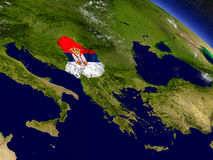 Serbia with embedded flag on Earth Royalty Free Stock Photos