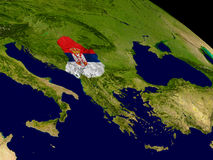Serbia with flag on Earth Stock Photos