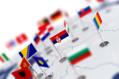 Serbia flag in the focus. Europe map with countries flags Royalty Free Stock Photography